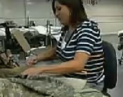 funny prison labor video link; thumb of prisoner using a sewing machine