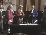 funny declaration of independence video link; thumb of founding fathers gathered around a signing table