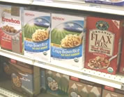 natural food scam video link; thumb of boxes of natural cereal on grocery store shelves