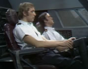 graham chapman and john cleese as airline pilots in cockpit; link for funny animation/video; opens in new window