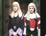 funny judges video link; thumb of Eric Idle and Michael Palin as poofy judges