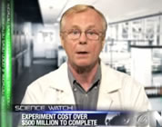 funny GMO video link; thumb of fake scientist on news screen