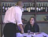 waiter talking to female customer in restaurant; click to go to video page at external site; opens in new window